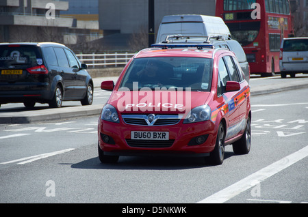 Red Diplomatic Protection unit Police car in London (going over Waterloo Bridge). - Stock Photo