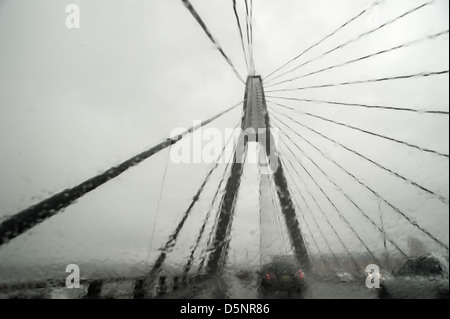 Passing over Sydney's Anzac Bridge on a wet winter's day - Stock Photo