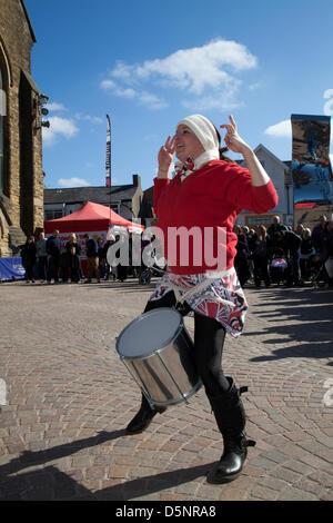 Blackpool, Lancashire, UK Saturday April 6th 2013. Batala Drummer, band, big drum, woman drummer, music, percussion, - Stock Photo
