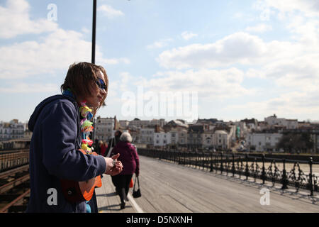 Ryde, Isle of Wight, UK. 6th April 2013 A busker greeting passengers to the sunny Isle of Wight today. Spring weather - Stock Photo