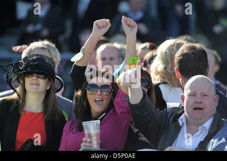 Aintree, UK. 6th April 2013.   The Grand National Festival. John Smith's Liverpool Hurdle. The crowd cheer the winners - Stock Photo