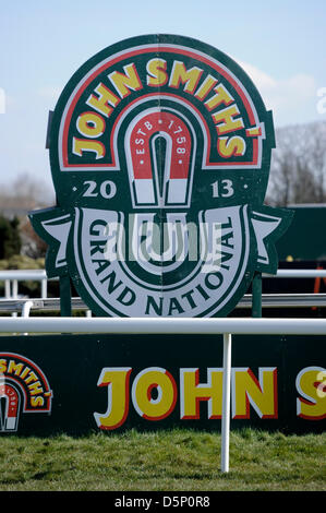 Aintree, UK. 6th April 2013.   The Grand National Festival shows the John Smith advertising boards at the finsh - Stock Photo