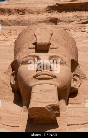 Close-up of one of the Colossal statues of Ramesses II, wearing the double crown of Lower and Upper Egypt Abu Simbel - Stock Photo