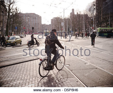 An elderly gent on his bicycle in Amsterdam, the Netherlands. - Stock Photo