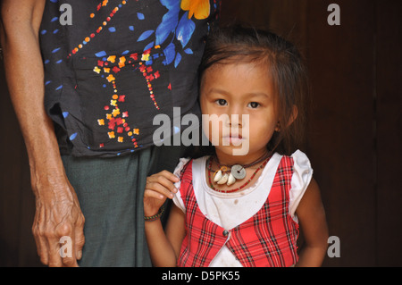 Portrait of a young girl in Laos with her mother - Stock Photo