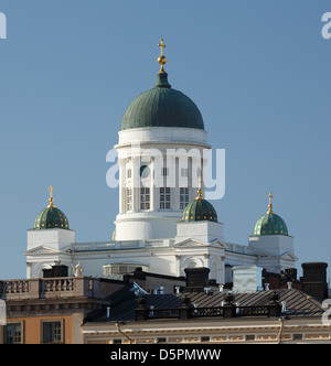 The domes of Helsinki Cathedral in April lit by afternoon sunlight. - Stock Photo