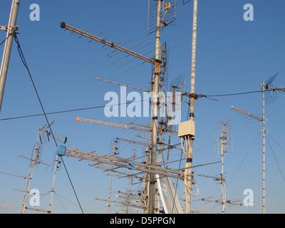 TV antennas on the roof - Stock Photo