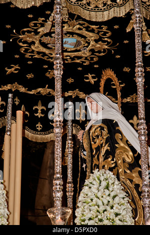 Virgin in procession on Easter Monday in Holy Week of Malaga, Andalusia, Spain - Stock Photo