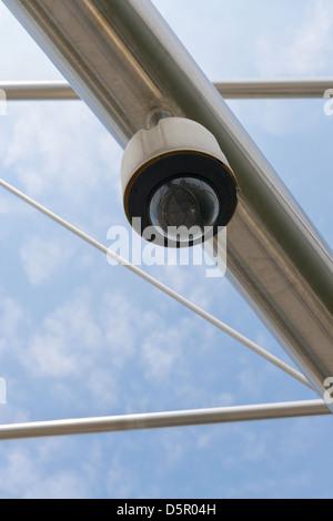 High tech overhead security camera with a blue sky. - Stock Photo