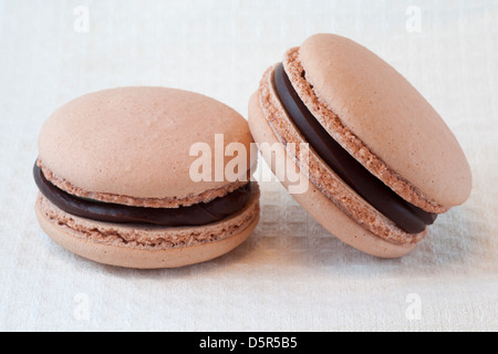 Peanut butter and chocolate flavoured macarons - Stock Photo