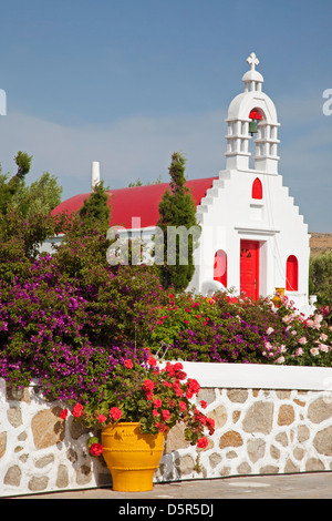 Small chapel surrounded by flower garden, in the interior of Mykonos island