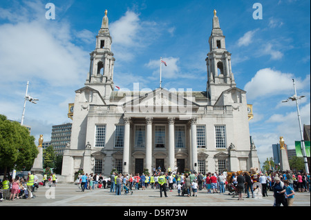 Hundreds gather in Millenium square in front of Leeds Civic Hall to protest against the planned closure - Stock Photo