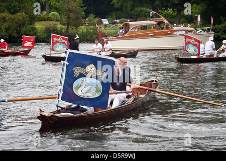 The Worshipful Company of Dyers row upstream on The River Thames during the annual swan upping ceremony. - Stock Photo