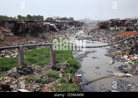 A small river in Accras Agbogbloshie township has become a polluted water body. - Stock Photo