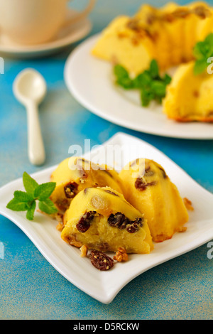 Cheese tart with walnuts and raisins. Recipe available. - Stock Photo