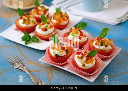 Plums with cheese. Recipe available. - Stock Photo