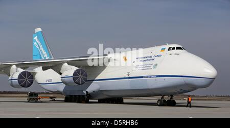 An employee stands in front of an Antonov An-124 at Leipzig/Halle Airport in Schkeuditz, Germany, 08 April 2013. - Stock Photo