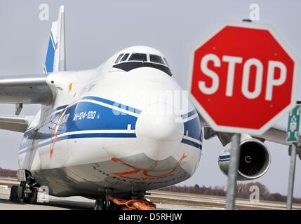 An Antonov An-124 is parked behind a stop sign at Leipzig/Halle Airport in Schkeuditz, Germany, 08 April 2013. The - Stock Photo