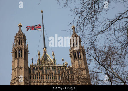 Union flag at half mast above the Houses of Parliament. In honour of Baroness Margaret Thatcher following the announcement - Stock Photo