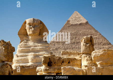 The Great Sphinx with the Pyramid of Khafre behind at Giza in Egypt - Stock Photo
