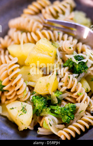 Bowl of pasta and veggies. - Stock Photo