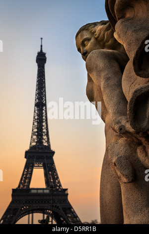 Sculptures from Jardins du Trocadero with the Eiffel Tower in the background, Paris, France - Stock Photo