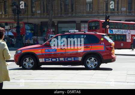 Red Diplomatic Protection unit Police car in London near Trafalgar Square. - Stock Photo