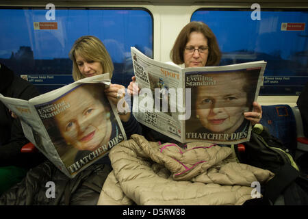 London, UK. 8th April, 2013.  Londonders on The Underground read of the death of ex-British Prime Minister, Baroness - Stock Photo