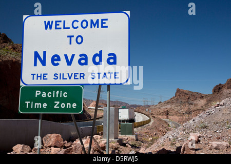 Boulder City, Nevada - A sign welcomes drivers on US 93 to Nevada as they cross a bridge from Arizona over the Colorado - Stock Photo