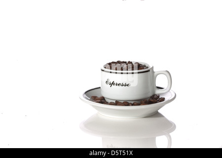 a coffee cup filled with beans - Stock Photo
