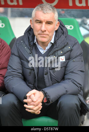 Hannover's head coach Mirko Slomka sits on the bench before the Bundesliga soccer match between Hannover 96 and - Stock Photo