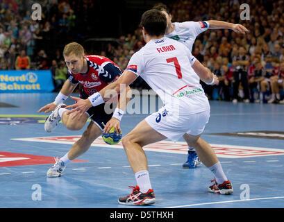 Flensburg's Steffen Weinhold throws the ball against Hamburg's Matthias Flohr during the Handball Champions League - Stock Photo