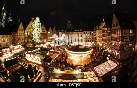 FILE - An archive picture dated 24 November 2010 shows the christmas market magnificantly lit at the Roemerberg - Stock Photo