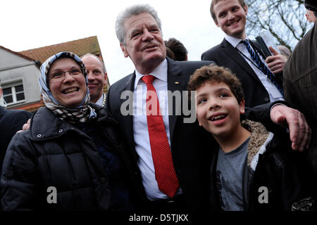 German federal president Joachim Gauck (c) talks to passersby during his inaugural visit to the state of North Rhine - Stock Photo
