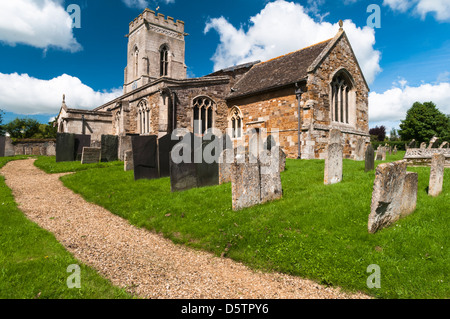 The church of St Peter and churchyard in the picturesque village of Belton-in-Rutland near Oakham, Rutland, England - Stock Photo
