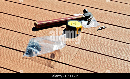 Tools for installing a composite wood floor. - Stock Photo