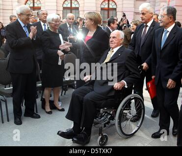 German Chancellor Angela Merkel (CDU, C) and former German Chancellor Helmut Kohl (C-R) arrive at a reception at - Stock Photo