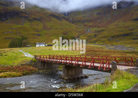 Bridge over the River Coe which leads to a cottage on the shores of Loch Achtriochtan in Glen Coe,Highland Region,Scotland,U.K. - Stock Photo
