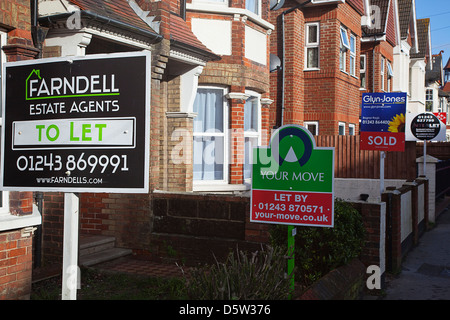England, West Sussex, Bognor Regis, To Let signs outside houses and flats. - Stock Photo