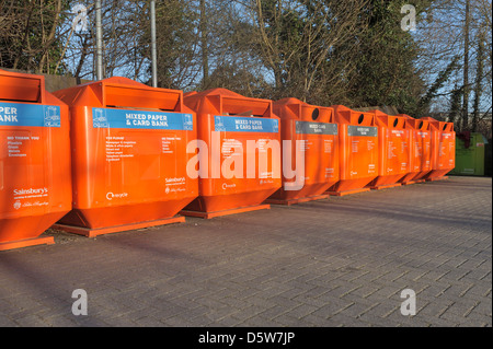 A row of recycling bins used for recycling paper, card bottles and cans etc - Stock Photo