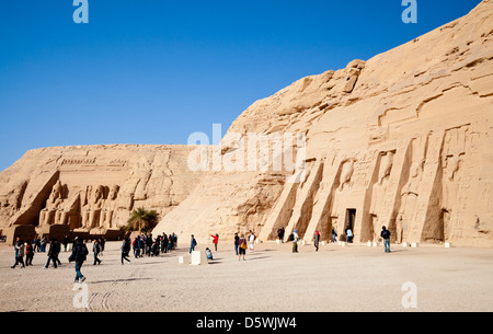 The Temple of Hathor and Nefertari (or the Small Temple) with the Great Temple in the distance at Abu Simbel, Egypt - Stock Photo