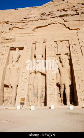 Three statues of Pharaoh Ramesses II and Queen Nefertari outside the Temple of Hathor and Nefertari at Abu Simbel, - Stock Photo