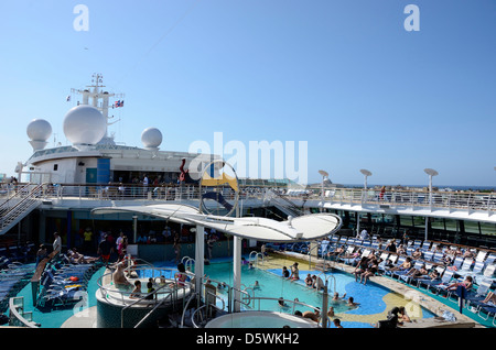 Pool deck and pool bar on Royal Caribbeans Brilliance of the Seas cruise ship. - Stock Photo