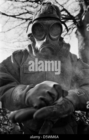 British soldier wearing nbc protective gear undergo training for a gas attack during an exercise. - Stock Photo
