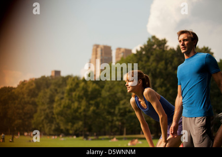 Couple resting in urban park - Stock Photo