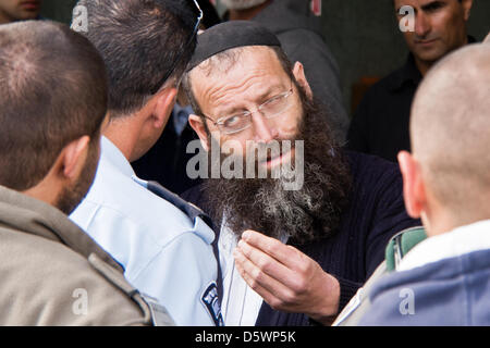 Jerusalem, Israel. 9-Apr-2013. Jewish right-wing activists, lead by Baruch Marzel (C), disrupt a commemoration procession - Stock Photo