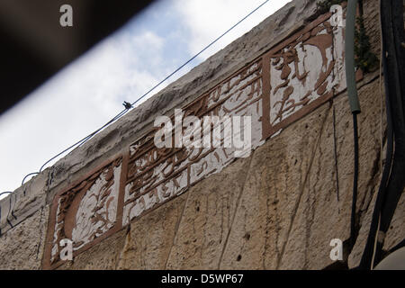 Jerusalem, Israel. 9-Apr-2013. An Arabic inscription above the doorway of a structure remaining from the village - Stock Photo