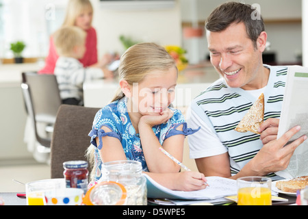 Father and daughter having breakfast - Stock Photo