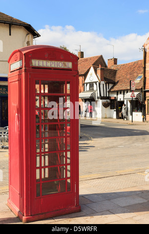 Traditional red public telephone box kiosk (K6) on a street in Stratford-upon-Avon, Warwickshire, England, UK, Britain - Stock Photo