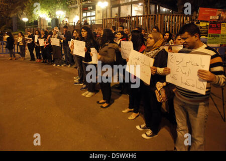 Jerusalem, April 9, 2013.  Palestinian demonstrators hold placards during a protest in solidarity with Samer al - Stock Photo